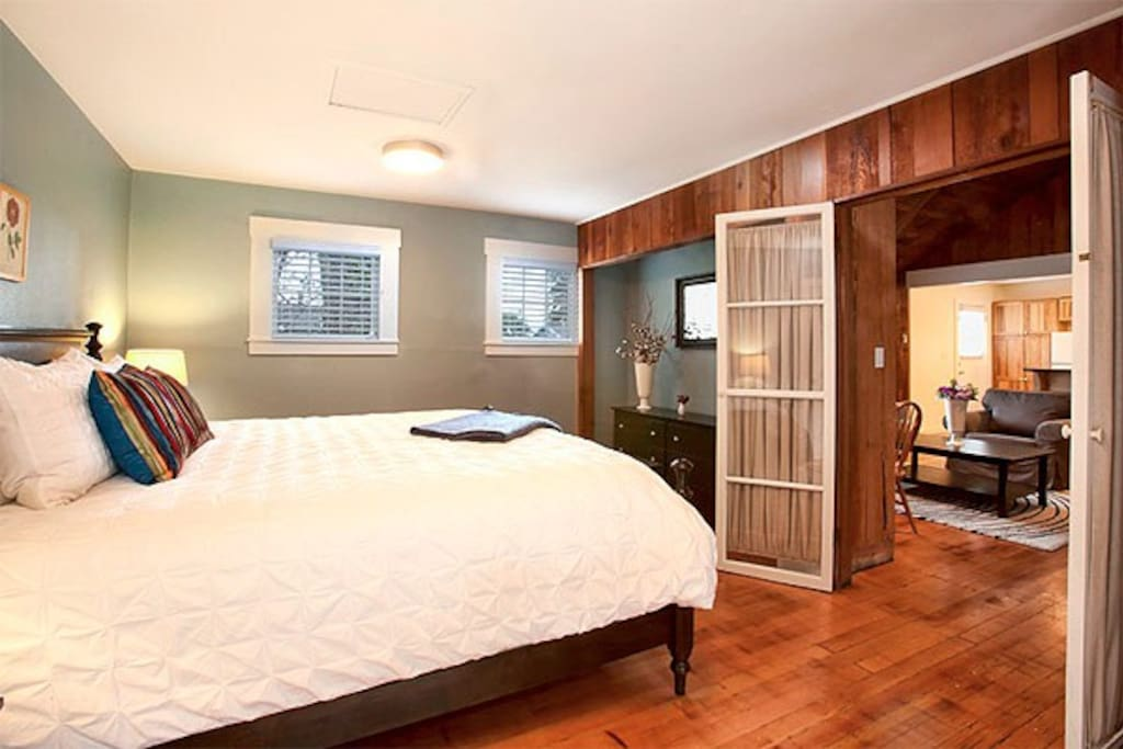 Ledford Cottage's master bedroom with king-sized bed. Ledford comfortably sleeps six people with two bedrooms.