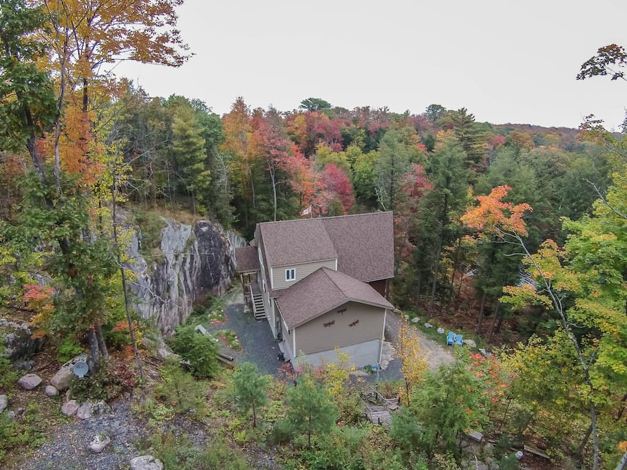 50 Foot Granite rockface with waterfall behind cottage