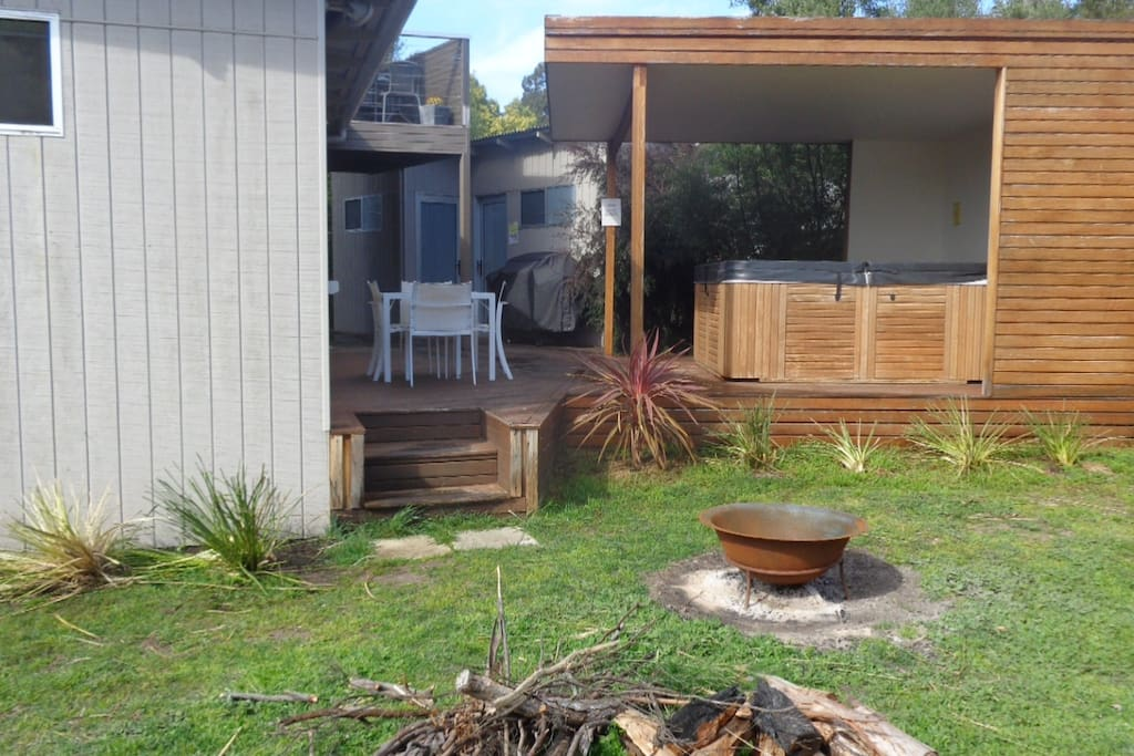 The 7 seat spa at 38 degrees off back deck with fire pot