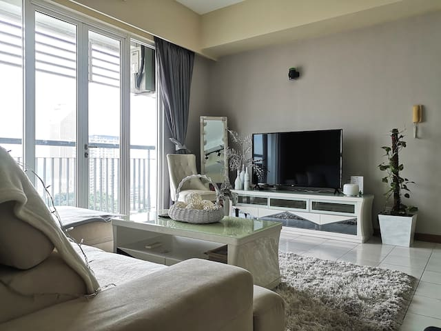 Comfy tv viewing with 60inch flat screen smart tv