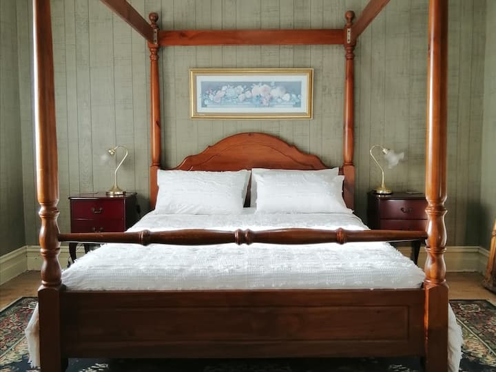 Four poster queen room at permaculture farmhouse