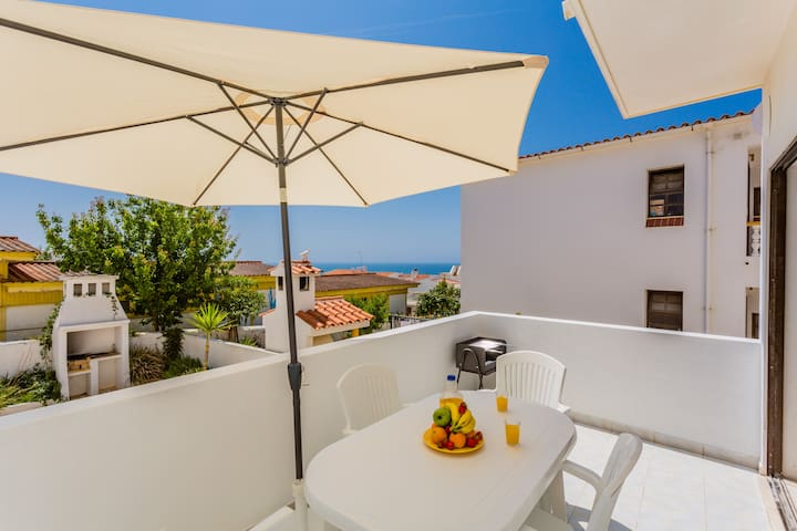 The balcony has a portable barbecue, a table and 4 chairs, also a sun umbrella for those lovely sunny days