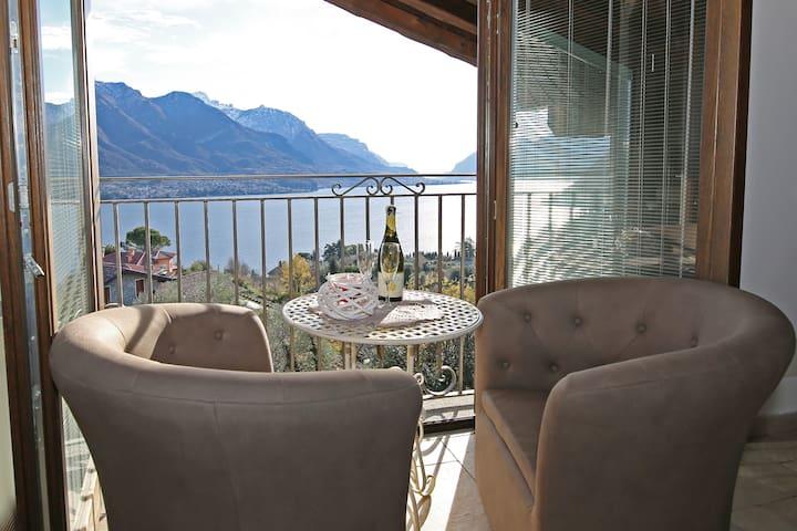 Alba cozy attic with breathtaking lake view,garden
