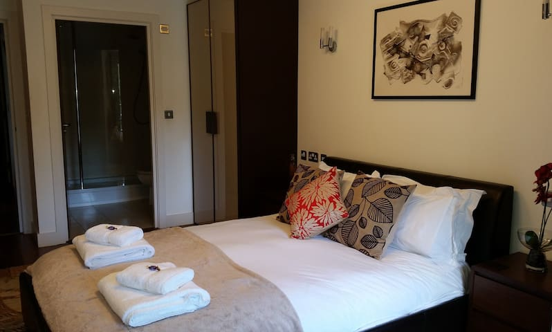 Master bedroom through to en-suite shower room.