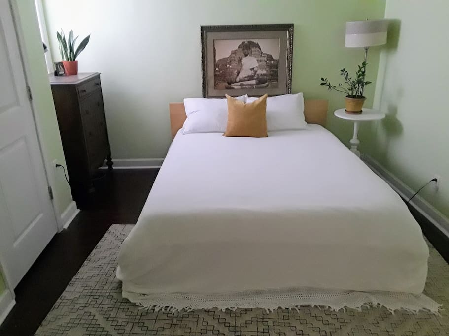 Serene guest room. Super comfy queen bed, dresser drawers empty, and a section of the closet is cleared for you to hang items.