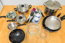 Our kitchen is fully equipped with pots, pans, crockery, cutlery and utensils.   The large pot at the back is our favourite as it mean we have caught mud crabs for dinner!
