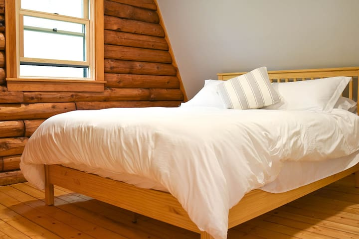 """2nd floor Queen bedroom called the """"Birch"""" room, has a view to the side gardens."""