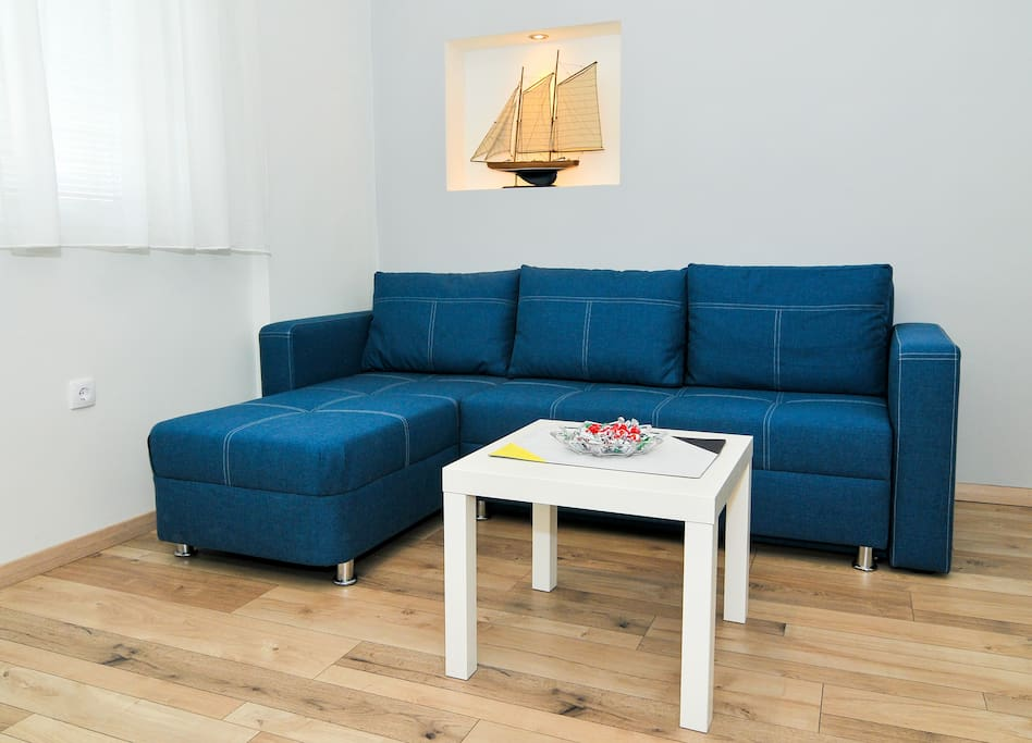 Comfortable sofa (transforming, for accomodation of two people) and coffee table