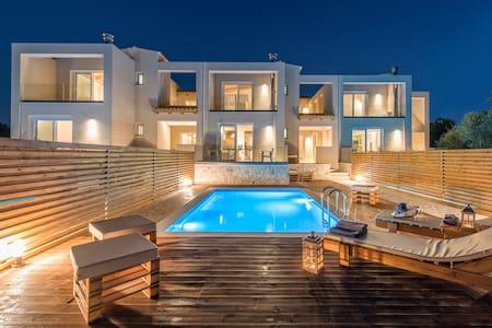 Dolce Luxury Suites - Villas - Psarou