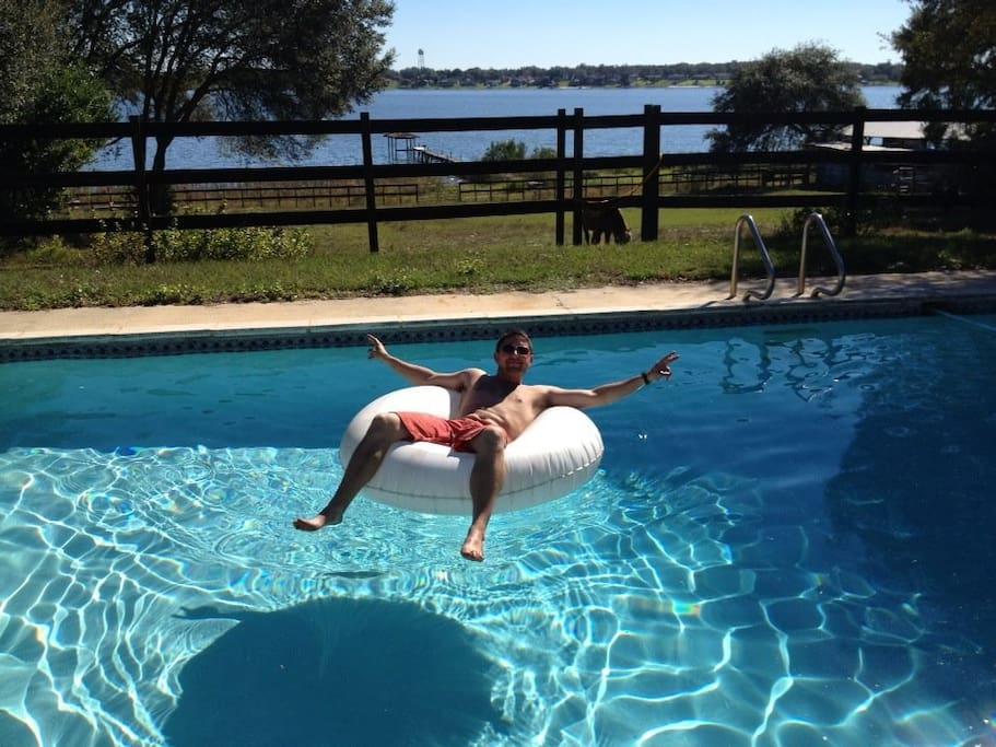 A guest from France in the middle of WINTER, loving the pool! See Eagle Lake behind pool!