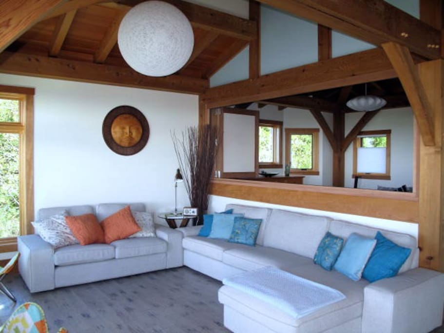 Open concept timber frame home. Opened shutters to master bedroom, to maximize taking in the view.