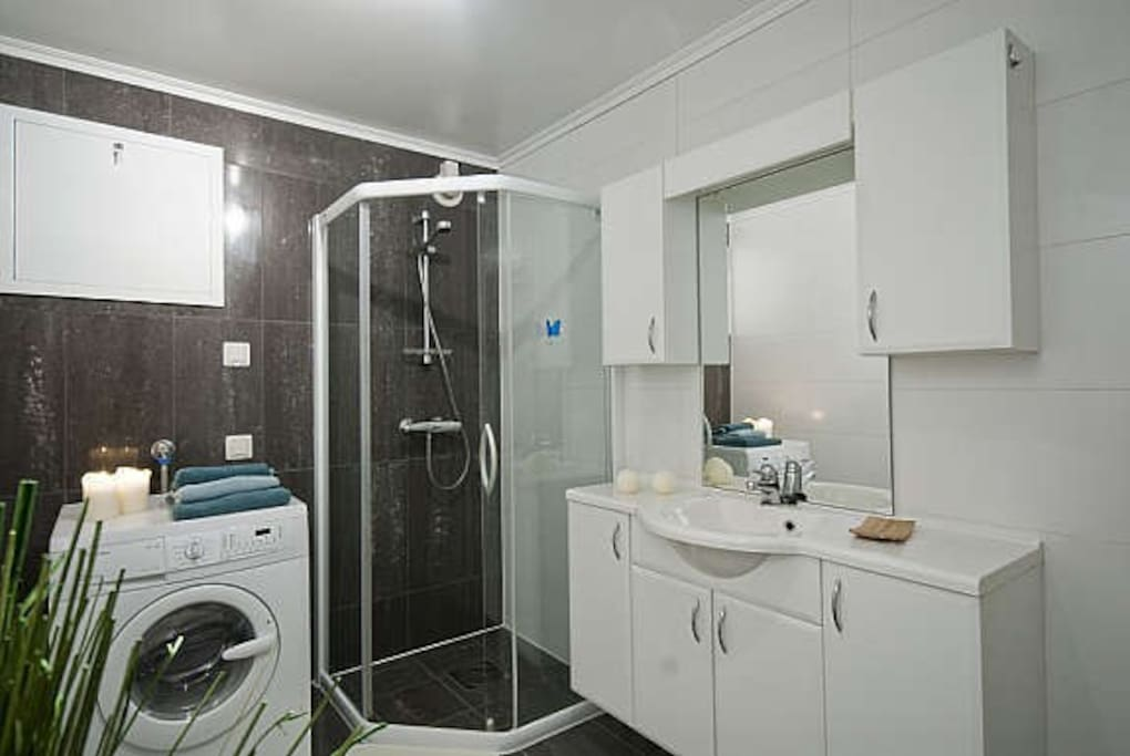 Bathroom with washing machine and dryer.