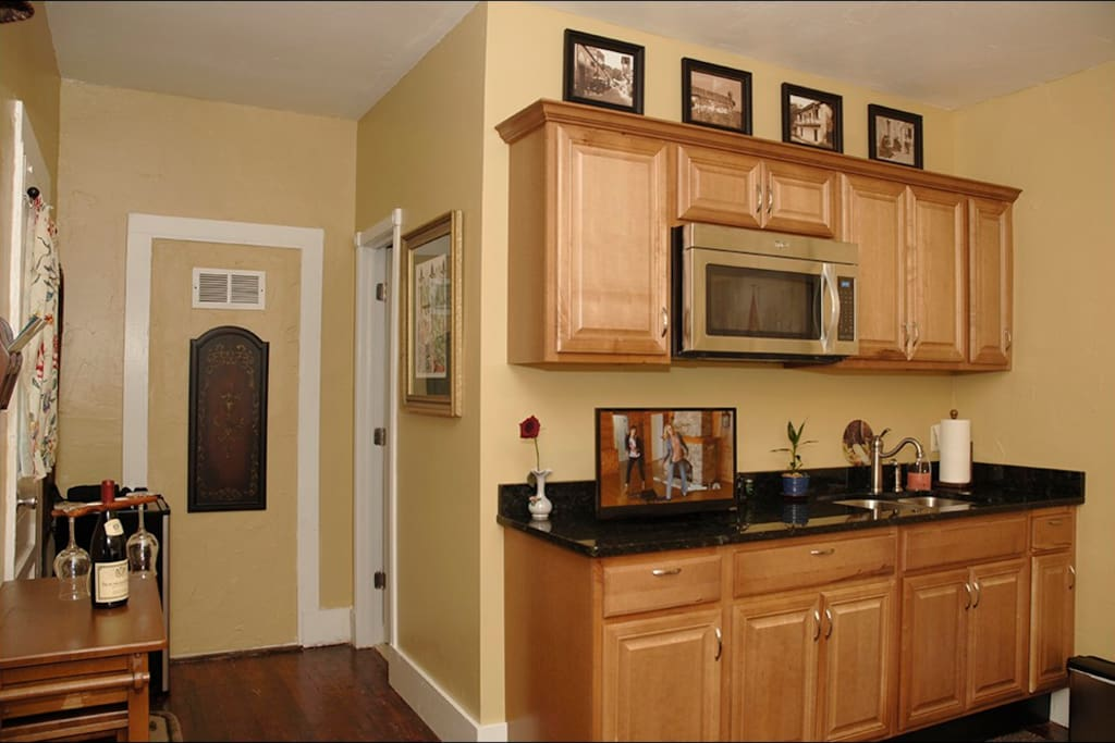 Kitchen area from different angle, bathroom door in background.