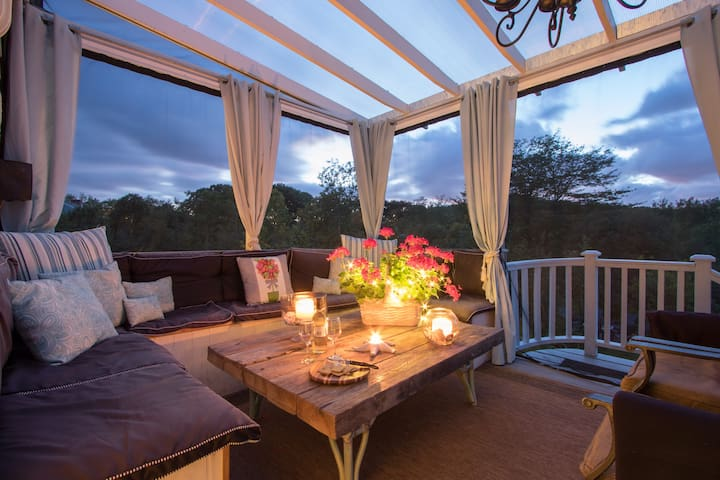 The gorgeous outdoor deck is a favorite hang out place day or night.