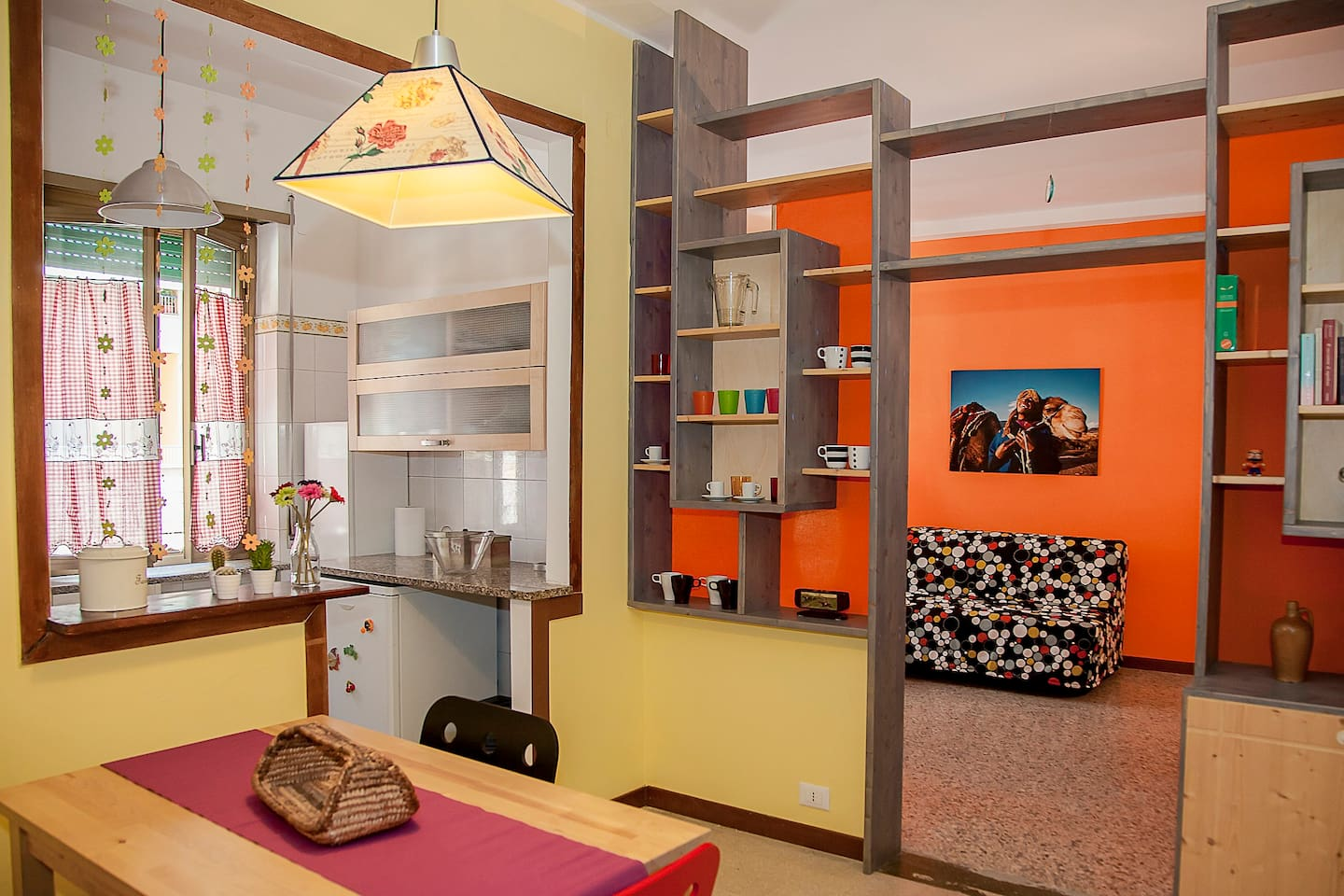 Dinette, kitchen, bookcase and living room