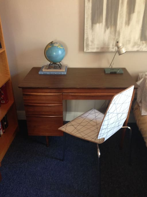 Great little desk with drawers to use and tones of travel brochures and maps inside