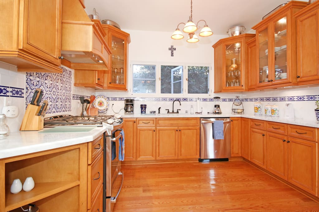 Recently remodeled kitchen with new appliances, cabinets and marble countertops.