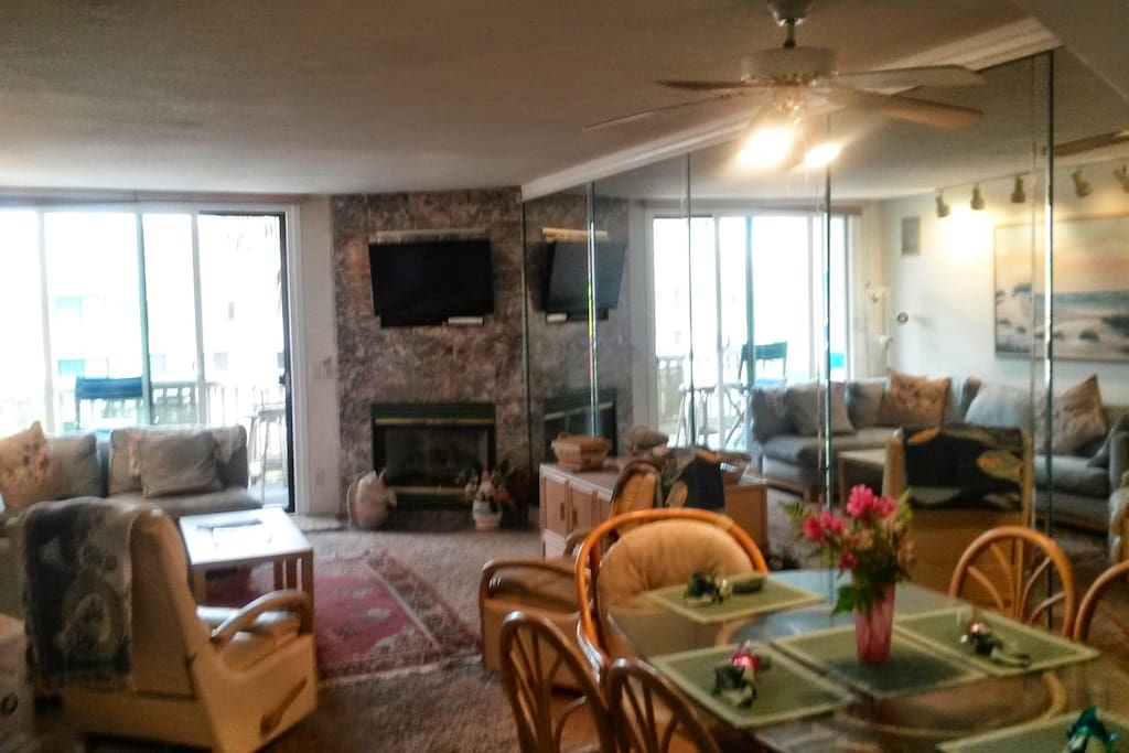 Living/Dining Area with fireplace, HD TV, Balcony & Queen Sleeper Sofa