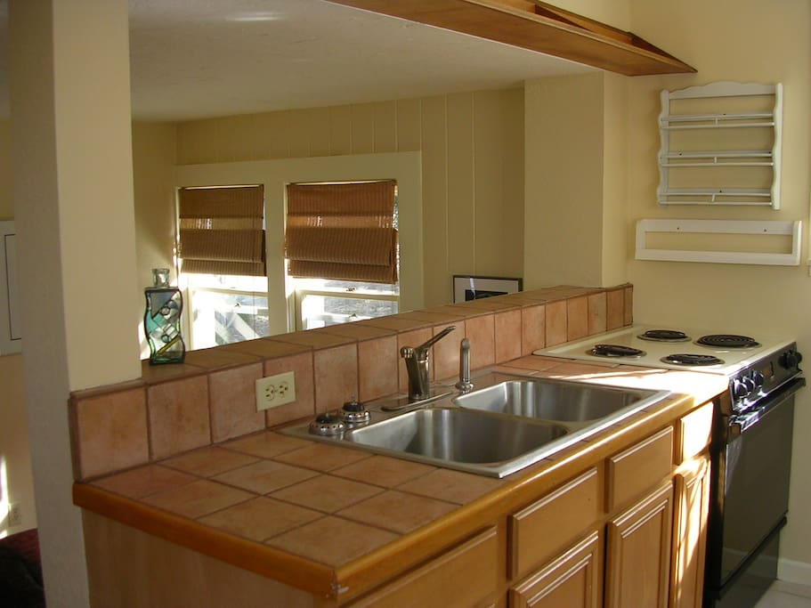 Spacious kitchen, up 3 steps from main room.