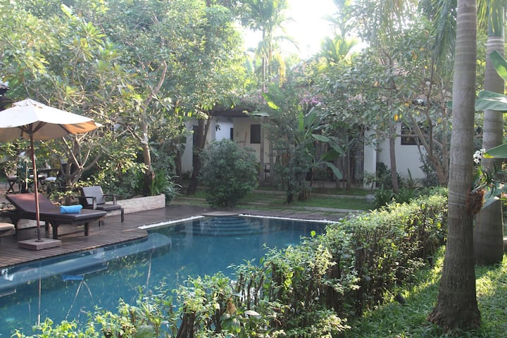 Cambodian Villan in tropical garden