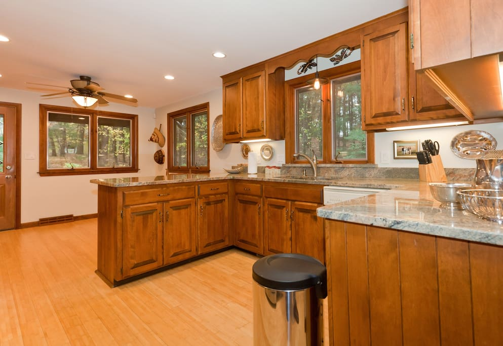 Welcoming kitchen with breakfast bar and private woodland view