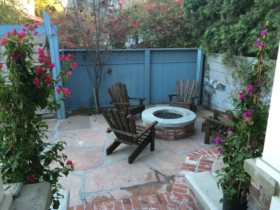 Enjoy a brick-lined expansive porch w/ built-in firepit, garden & outdoor shower after surfing.