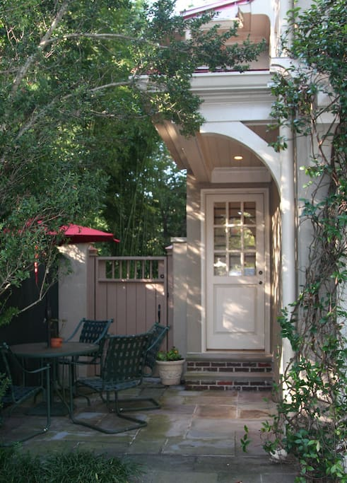 Entrance and private patio area. Second floor suite overlooks leafy nature preserve to the rear and landscaped backyard of our 1925 home to the front. We are happy to assist with your bags up the stairs.