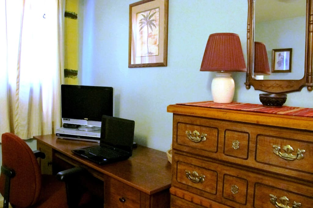 The desk, chair and  TV/DVR are great for working and relaxing.