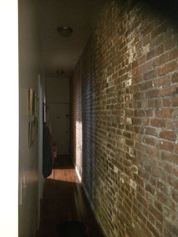 New York style, pre-war brick wall and high ceilings.
