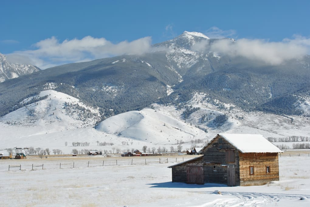 View from the porch of the cabin of historic barn and the Absaroka Beartooth Mountains