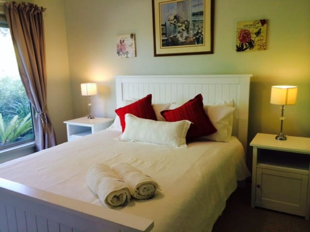 The main bedroom offering a queen size bed and views of the farm