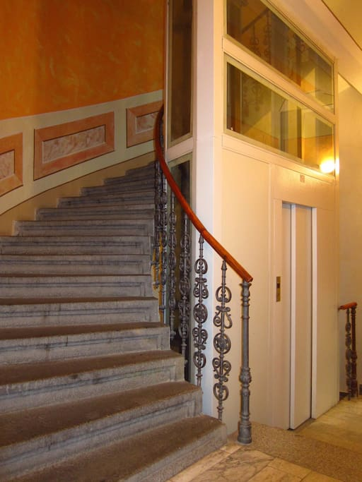 Old staircase and new elevator