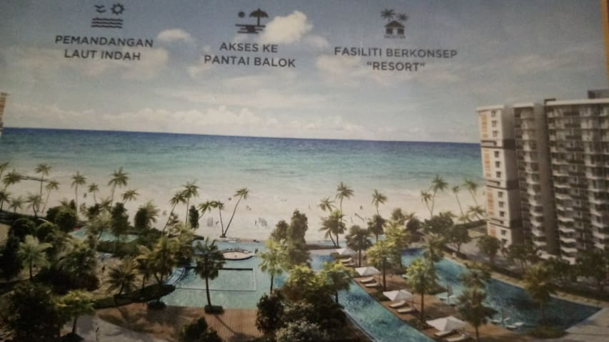 Beachfront residence with resort facilities.