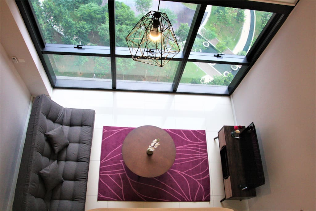 Tall windows giving the duplex ample light- it gives the place a spacious yet cosy feel at the same time