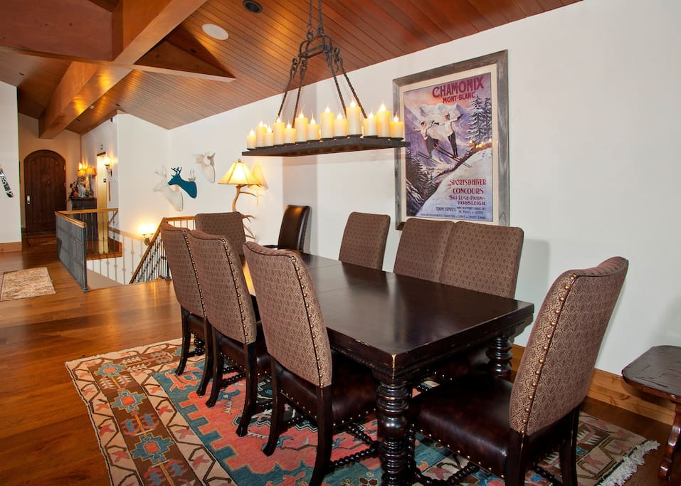 Entertain visitors and enjoy meals together at the grand dining room table.