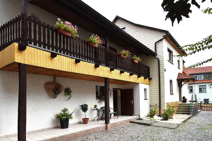 Holiday home in Thuringia with private terrace, use of a garden and pool