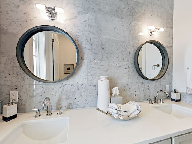 Convenient dual vanity in the master bathroom. A starter supply of toiletries and bath amenities is provided.