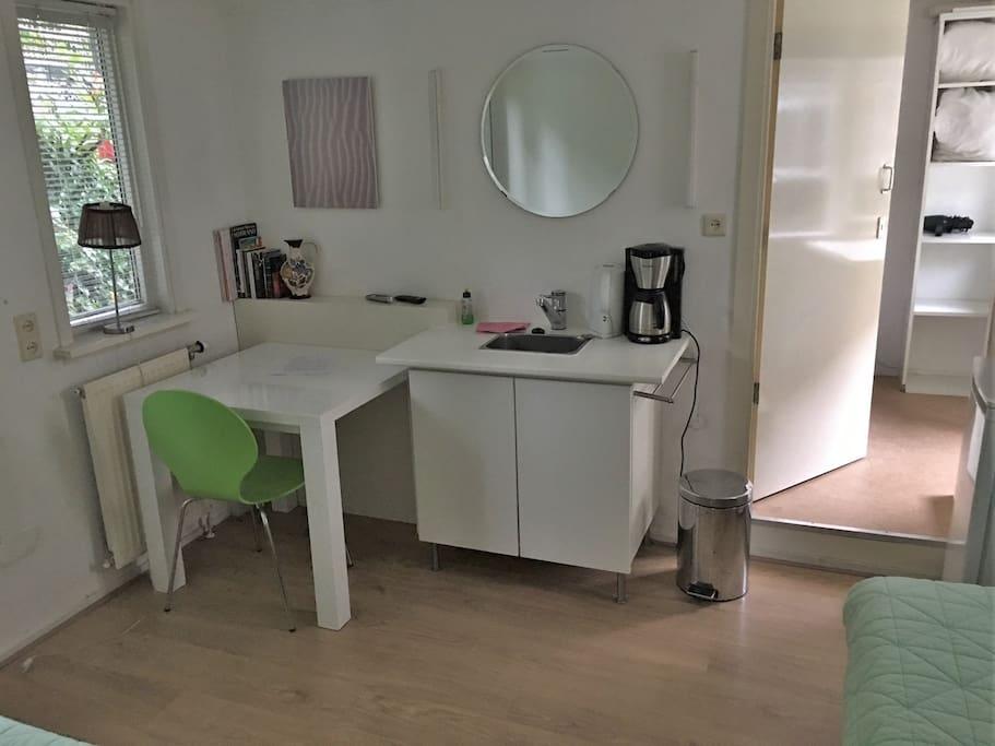 Room-1: Sink diner table coffee machine