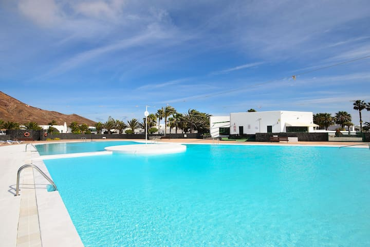Holiday Home with Wi-Fi, Terrace, Pool and Tennis Court