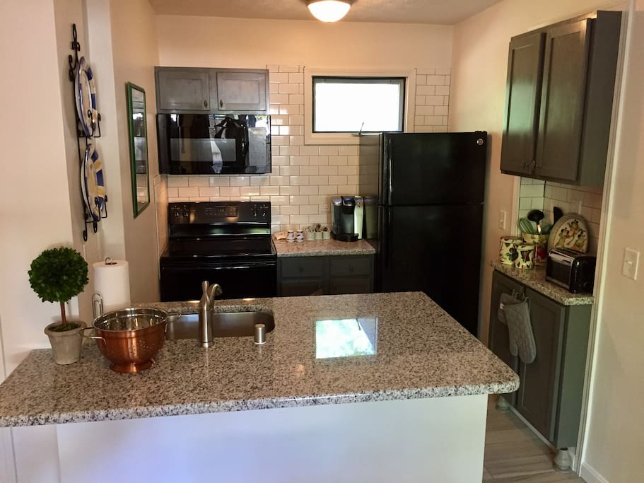 All new granite and appliances - dishwasher, range, microwave and fridge with ice maker