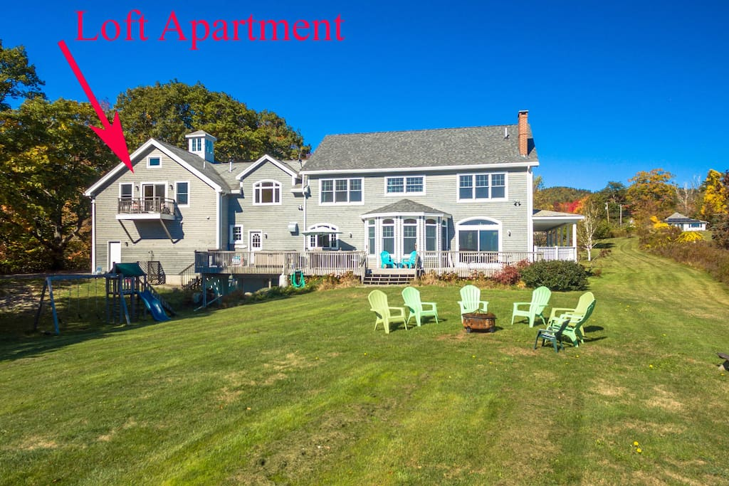 Gently sloping and grassy lawn area leading to private beach area. Enjoy evening fires outside on beach or in firepit and watch the moonrise and stars.