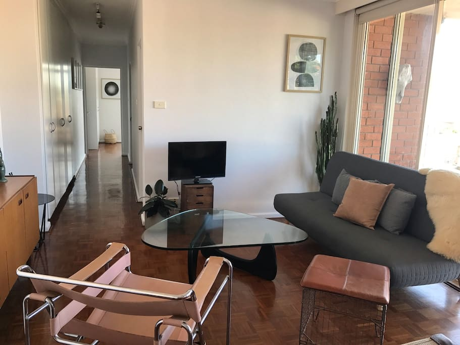Relax in our spacious, bright and airy living room and enjoy the sea breeze and sunshine ☀️