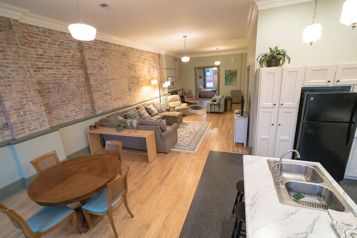 Exposed brick wall adds to the historical feel