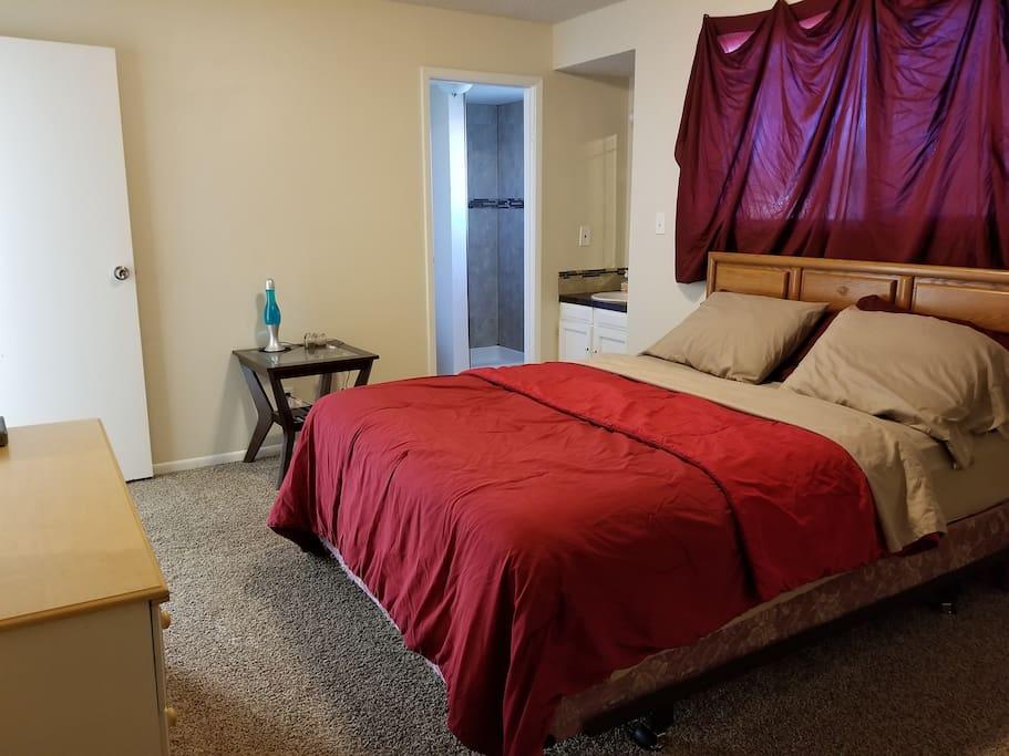 Master bedroom with queen mattress