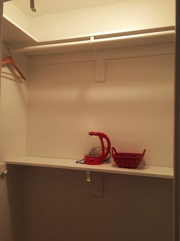 walk-in closet with hot kettle.