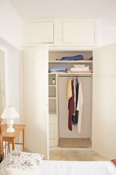 wardrobe with plenty space, hangers and drawers