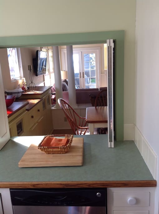 Kitchen pass-through to dining area.