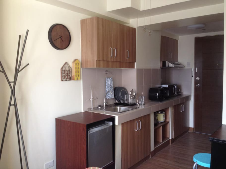 Kitchen with min-fridge, microwave oven, toaster, coffee maker and convection range