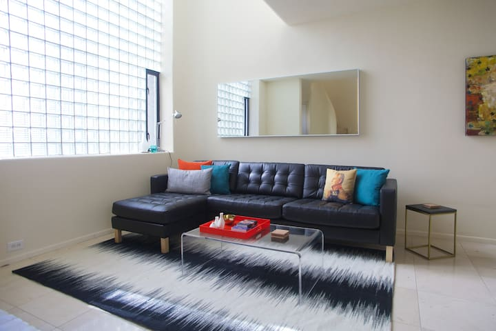 Comfy leather couch to lounge on while enjoying Netflix, Apple TV and HBO Now!
