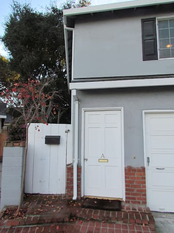 Private Entrance to 1Br/1Ba unit is to left of garage